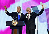 United States Vice President Mike Pence, left, and Mort Fridman, President, AIPAC Board of Directors, right, as Pence begins to speak at the American Israel Public Affairs Committee (AIPAC) 2019 Policy Conference at the Washington Convention Center in Washington, DC on Monday, March 25, 2019.<br /> Credit: Ron Sachs / CNP<br /> (RESTRICTION: NO New York or New Jersey Newspapers or newspapers within a 75 mile radius of New York City)