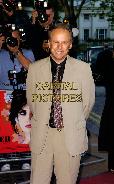 "NICK PARK.""Volver"" UK film premiere, Curzon Mayfair, London, UK..August 3rd, 2006.Ref: CAN.half length beige suit jacket.www.capitalpictures.com.sales@capitalpictures.com.©Can Nguyen/Capital Pictures"