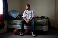 Chase Main, 31, player on the Fort Belknap College Eagles basketball team, poses for a portrait in his home near the Fort Belknap Agency, Montana, USA.