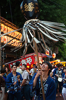 Yushima Shrine Matsuri - Matsuri is the Japanese word for a festival which are usually sponsored by a local shrine or temple. There is no specific matsuri days for all of Japan.  Dates vary from area to area but festival days do tend to cluster around traditional holidays such as Setsubun or Obon. Almost every locale has at least one matsuri in late summer or early autumn, usually related to the rice harvest..Matsuri often feature processions which may include elaborate floats. Preparation for these processions is usually organized at the level of neighborhoods.  Prior to these, the local kami will be ritually installed in mikoshi, portable shrines, and paraded through the streets.