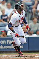 Atlanta Braves right fielder Jason Heyward #22 swings at a pitch during a game against the Colorado Rockies at Turner Field on September 3, 2012 in Atlanta, Georgia. The Braves  defeated the Rockies 6-1. (Tony Farlow/Four Seam Images).