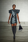 Model walks runway in an outfit from the Rorisang Ratsui collection for Free Fashion Week at Cope NYC, on October 11, 2019, during Fashion Week Brooklyn Spring Summer 2020.