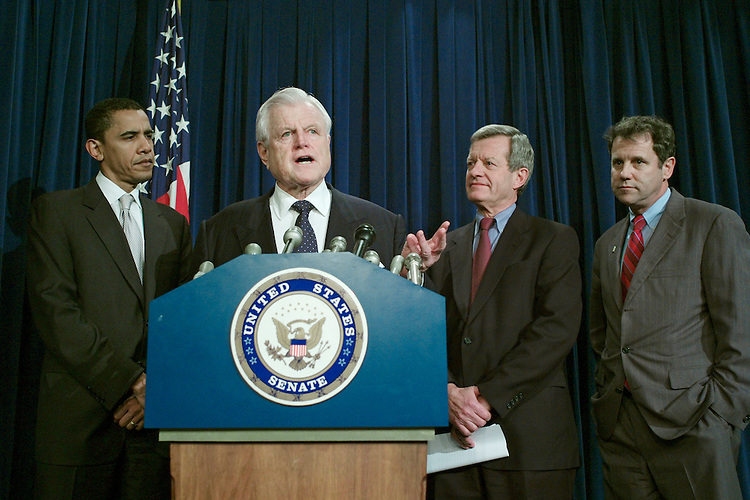 02/01/07--Sen. Barack Obama, D-Ill., Sen. Edward M. Kennedy, D-Mass., Sen. Max Baucus, D-Mont., and Sen. Sherrod Brown, D-Ohio, during a news conference after the Senate capped a two-week debate by passing a bill that combines the first minimum wage increase in a decade with a package of tax breaks for small businesses. (Obama will officially announce a bid for the 2008 Democratic presidential nomination Feb. 10 in an event in his home stateÕs capital of Springfield.) The legislation would boost the federal minimum by $2.10 an hour, to $7.25, in three steps over two years. It also would extend about $8.3 billion in business tax breaks for varying periods, with the costs offset by a new $1 million cap on how much tax-deferred compensation business executives can receive each year and selected other revenue-raisers. The 94-3 vote on the measure (HR 2) paves the way for potentially difficult negotiations with the House. Speaker Nancy Pelosi, D-Calif., guided a stand-alone wage increase through that chamber, and objected to the SenateÕs decision to attach the business tax breaks to it. Congressional Quarterly Photo by Scott J. Ferrell
