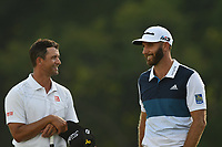Adam Scott (AUS) and Dustin Johnson (USA) talk on the 18th green  after their round of the 100th PGA Championship at Bellerive Country Club, St. Louis, Missouri.<br /> Picture Tom Russo / Golffile.ie<br /> <br /> All photo usage must carry mandatory copyright credit (© Golffile | Tom Russo)