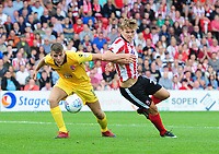 Lincoln City's Sean Raggett vies for possession with Morecambe's Sam Lavelle<br /> <br /> Photographer Chris Vaughan/CameraSport<br /> <br /> The EFL Sky Bet League Two - Lincoln City v Morecambe - Saturday August 12th 2017 - Sincil Bank - Lincoln<br /> <br /> World Copyright &copy; 2017 CameraSport. All rights reserved. 43 Linden Ave. Countesthorpe. Leicester. England. LE8 5PG - Tel: +44 (0) 116 277 4147 - admin@camerasport.com - www.camerasport.com