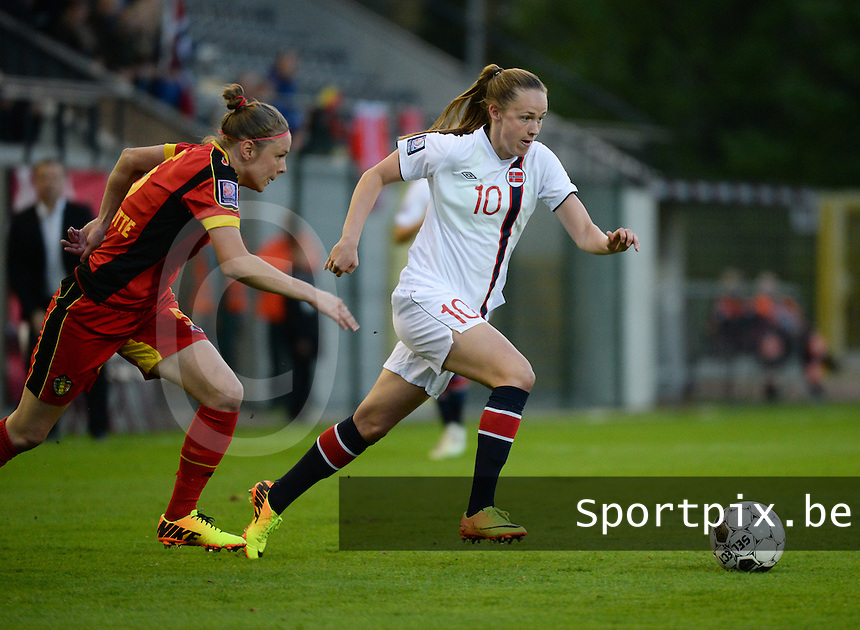 20140410 - LEUVEN , BELGIUM : Norway Caroline Hansen (10) pictured with Belgian Lorca Van De Putte (left) during the female soccer match between Belgium and Norway, on the seventh matchday in group 5 of the UEFA qualifying round to the FIFA Women World Cup in Canada 2015 at Stadion Den Dreef , Leuven . Thursday 10th April 2014 . PHOTO DAVID CATRY