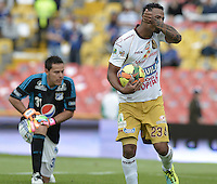 BOGOTÁ -COLOMBIA, 03-11-2013. Charles Monsalvo (Der.) del Deportes Tolima celebra un gol en contra del Millonarios durante partido por la fecha 17 de la Liga Postobón  II 2013 jugado en el estadio Nemesio Camacho el Campín de la ciudad de Bogotá./ Deportes Tolima player Charles Monsalvo (R) celebrates a goal against Millonarios during match for the 17th date of the Postobon  League II 2013 played at Nemesio Camacho El Campin stadium in Bogotá city. Photo: VizzorImage/Gabriel Aponte/STR