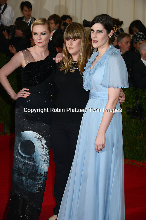 Kirsten Dunst and Rodart designers attends the Costume Institute Benefit on May 5, 2014 at the Metropolitan Museum of Art in New York City, NY, USA. The gala celebrated the opening of Charles James: Beyond Fashion and the new Anna Wintour Costume Center.