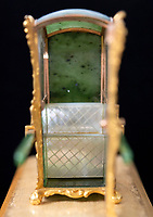 BNPS.co.uk (01202 558833)<br /> Pic: PhilYeomans/BNPS<br /> <br /> The sedan seat is crafted from mother of pearl...<br /> <br /> In from the cold - £500,000 Romanov treasure is hot property at Cotswold auction.<br /> <br /> An exquisite Faberge antique believed to have been made for the Russian Royal family over 100 years ago sold yesterday for a whopping £500,000...over 5 times it's estimate.<br /> <br /> The model of a sedan chair by the iconic Russian jewellers was one of the state treasures seized and sold off by the communist regime following the Russian Revolution.<br /> <br /> It was first sold at high-end Anglo-Russia antique dealers Wartski in London in 1929, where it was bought by a K.W Woollcombe-Boyce for only £75.<br /> <br /> The ornate item, crafted from Jadeite, gold, rock crystal and mother of pearl, has remained in the family ever since and is now being sold by a direct descendant of Mr Woollcombe-Boyce.<br /> <br /> Experts from the Cotswold Auction Company gave the small Russian antique a pre-sale estimate of only £100,000, but always anticipated it could go for much more than that.