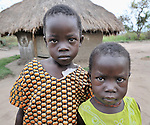 Two children in the Southern Sudan village of Ligitolo. Families here are rebuilding their lives after returning from refuge in Uganda in 2006 following the 2005 Comprehensive Peace Agreement between the north and south. NOTE: In July 2011, Southern Sudan became the independent country of South Sudan