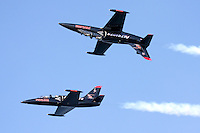Two aircraft of the Patriots Jet Demonstration Team in flight during the 2009 San Francisco Fleet Week. The Patriots fly the Czechoslavakian built L-39 Albatross Trainer.