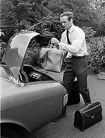 Mike Gibson, Irish, International, rugby player, packing his bags into boot of his car at his home, Belfast, N Ireland. Photo taken just before Mike Gibson left on British &amp; Irish Lions Tour of South Africa. 351/74, 197406200351B<br />