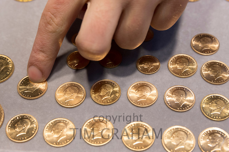 Gold Turkish lira coins Turk Lirasi 22 carat Ataturk image in The Grand Bazaar, Kapalicarsi, great market, Istanbul, Turkey
