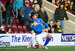 Motherwell v St Johnstone...28.01.12  .Darren Randolph grabs Fran Sandaza after he fouled Tim Clancy.Picture by Graeme Hart..Copyright Perthshire Picture Agency.Tel: 01738 623350  Mobile: 07990 594431
