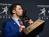 New York, NY - December 9, 2017: Oklahoma quarterback Baker Mayfield Poses with the Heisman Trophy at the New York Marriott Marquis in New York City after winning the 83rd Heisman Trophy award, December 9, 2017. Mayfield, a repeat finalist for the award, completed 71 percent of his passes for 4,340 yards and 41 touchdowns.  (Photo by Don Baxter/Media Images International)