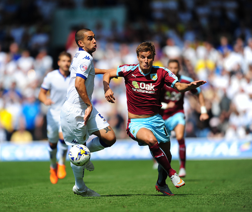 Burnley's Jelle Vossen vies for possession with Leeds United's Giuseppe Bellusci<br /> <br /> Photographer Chris Vaughan/CameraSport<br /> <br /> Football - The Football League Sky Bet Championship - Leeds United  v Burnley - Saturday 8th August 2015 - Elland Road - Beeston - Leeds<br /> <br /> &copy; CameraSport - 43 Linden Ave. Countesthorpe. Leicester. England. LE8 5PG - Tel: +44 (0) 116 277 4147 - admin@camerasport.com - www.camerasport.com