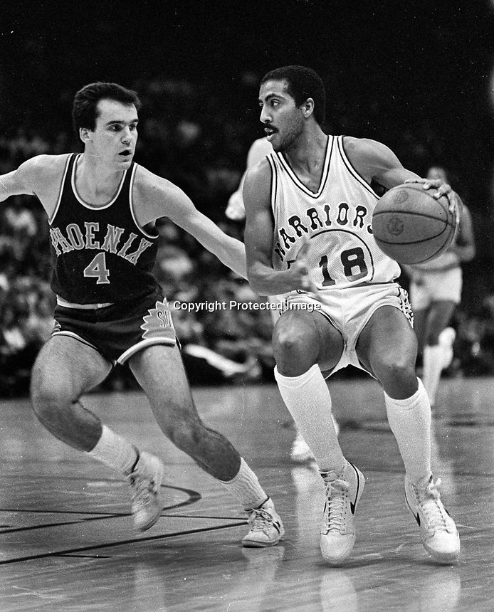 Golden State Warriors Lorenzo Romar with Phoenix Suns #4.....(1981 photo/Ron Riesterer)
