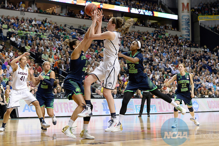 08 APR 2014:  Jewell Loyd (32) and Taya Reimer (12) of Notre Dame University defend Breanna Stewart (30) of the University of Connecticut during the Division I Women's Basketball Championship held at Bridgestone Arena in Nashville, TN.  Connecticut defeated Notre Dame 78-63 for the national title.  Jamie Schwaberow/NCAA Photos