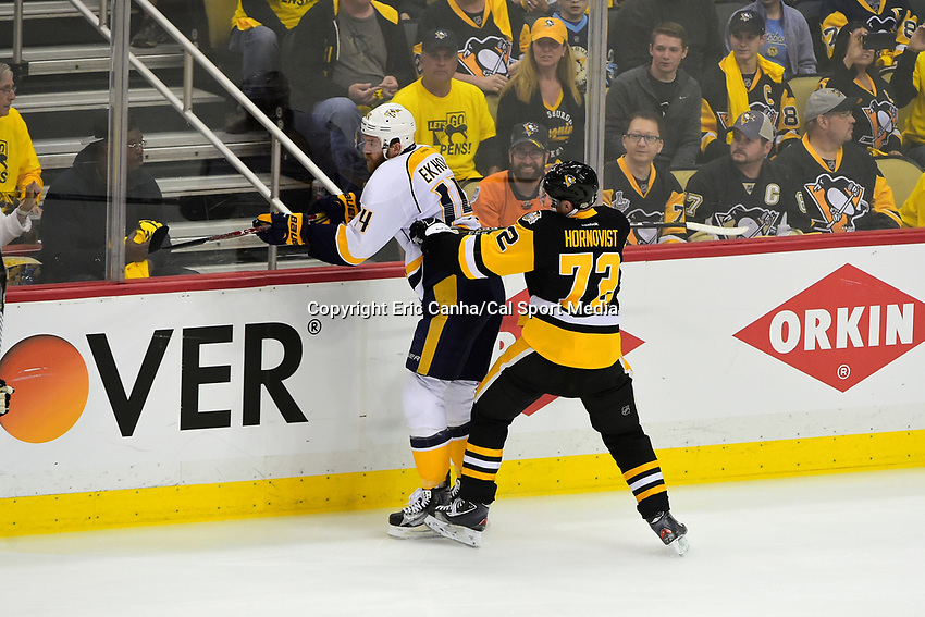 May 31, 2017: Pittsburgh Penguins right wing Patric Hornqvist (72) checks Nashville Predators defenseman Mattias Ekholm (14) during game two of the National Hockey League Stanley Cup Finals between the Nashville Predators  and the Pittsburgh Penguins, held at PPG Paints Arena, in Pittsburgh, PA. The Penguins defeat the Predators 4-1 and lead the series 2-0. Eric Canha/CSM