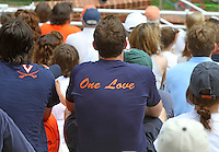 "Fans wore memorial t-shirt that said ""One Love"" before the first University of Virginia women's lacrosse game since the tragic death of teammate Yeardley Love Sunday May 16, 2010 at Klockner Stadium in Charlottesville, Va. The Cavaliers rallied in the last four minutes to beat Towson 14-12  and reach the quarter finals of the NCAA tournament. Love's body was found May 3, and Virginia men's lacrosse player George Huguely is charged with murder. Photo/Andrew Shurtleff..."