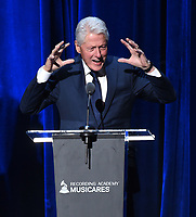 NEW YORK - JANUARY 26: President Bill Clinton presents Fleetwood Mac with their award at the 2018 MusiCares Person of the Year honoring Fleetwood Mac at Radio City Music Hall on January 26, 2018 in New York City. (Photo by Frank Micelotta/PictureGroup)