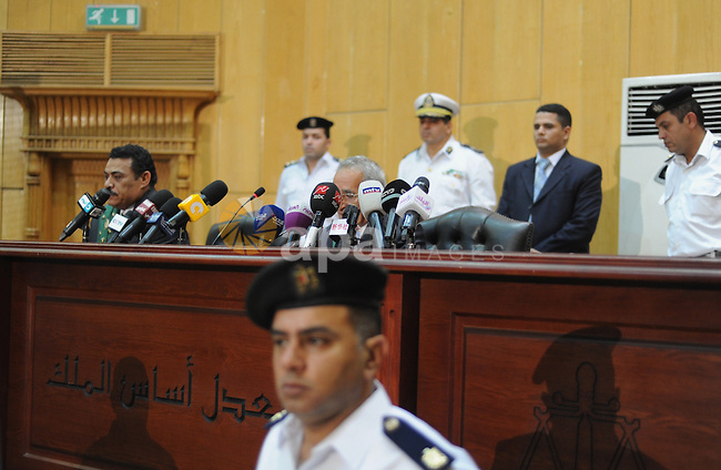 Egyptian Judge Hassan Hassanin speaks to media during the trial of ousted Egyptian President Hosni Mubarak on May 9, 2015 in the capital Cairo. The Egyptian court sentenced Mubarak and his two sons to three years in prison. Photo by Stranger