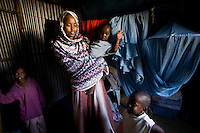 Siida Noor Ahmed and her children Iqra,7 years old, Nimo 3 years old, and  Yasin 4 years..Siida fled Mogadishu and arrived in Hargeysa's State House IDP camp in January