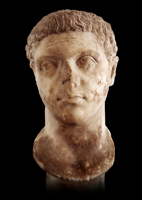 Roman sculpture of the Emperor Caracalla, excavated from Thuburbo-Majus, sculpted circa 211-217AD. The Bardo National Museum, Tunis, Inv No: C. 1347.  Against a black background.