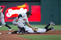 Indianapolis Indians shortstop Gift Ngoepe (17) fields the throw as Yoan Moncada (10) of the Charlotte Knights slides head first into second base at BB&T BallPark on June 16, 2017 in Charlotte, North Carolina.  The Knights defeated the Indians 12-4.  (Brian Westerholt/Four Seam Images)