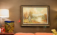 """Banksy fans flock to the Housing Works Thrift Shop in the Gramercy Park neighborhood of New York on Tuesday, October 29, 2013 to see """"The banality of the banality of evil""""  the twenty-ninth installment of Banksy's graffiti art. The artwork is a thrift store painting of a pastoral scene with a Nazi figure painted in and then re-donated to the thrift store.  The elusive street artist is creating works around the city each day during the month of October called """"Better Out Than In"""". The piece will be auctioned off on the """"Bidding for Good"""" website for two days starting at $74,000.  (© Richard B. Levine)"""