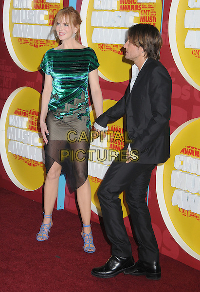 Nicole Kidman & Keith Urban.2011 CMT Music Awards held at Bridgestone Arena, Nashville, Tennessee, USA, 8th June 2011..country arrivals full length dress black sheer tulle see thru through hand waving strappy sandals green velvet striped  blue holding hands grey gray suit  couple husband wife .CAP/ADM/LF.©Laura Farr/AdMedia/Capital Pictures.