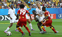 USA's Kristie Mewis (#9) misses to score against goalkeeper Patricia Mantey of Ghana during the FIFA U20 Women World Cup at the Rudolf Harbig Stadium in Dresden, Germany on July 14th, 2010.