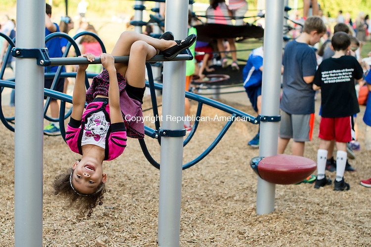 SOUTHBURY, CT - 24 September 2015-092415EC05-- Hailey Killian, a second grader at Pomperaug Elementary School, tries out a new playground at her school. The PTO celebrated the unveiling of a new playscape, which coincided with the annual back to school picnic. Erin Covey Republican-American.