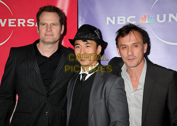 JACK COLEMAN, JAMES KYSON LEE & ROBERT KNEPPER .NBC Universal Press Tour Cocktail Party held at the Langham Hotel, Pasadena, California, USA, 10th January 2010..half length black grey gray hat suit tie jumper sweater shirt .CAP/ADM/BP.©Byron Purvis/AdMedia/Capital Pictures.