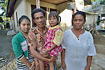 In the tsunami-ravaged village of Kuala Tadu in Indonesia's Aceh province, Church World Service, a member of the ACT Alliance, helped survivors build more than 200 new houses, including this one belonging to Zulkifli and his wife Rosdiana, here standing with their daughters Fitriani, 16, and Sofiani, 5.