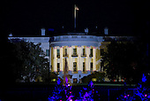 The South Portico of the White House is adorned for the holidays in this view from the Ellipse as United States President Barack Obama and the First Family attended the National Christmas Tree Lighting on the Ellipse in Washington, DC on Thursday, December 1, 2016.<br /> Credit: Ron Sachs / Pool via CNP