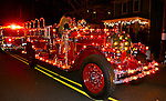 Antique fire truck with holiday lights in Cape May Christmas parade Family activities