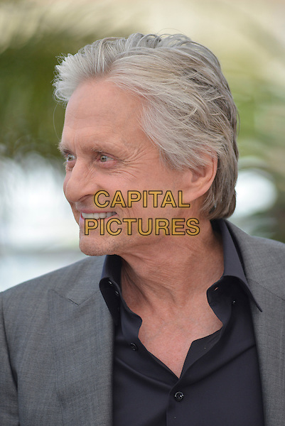 Michael Douglas.'Behind the Candelabra' photocall  at the 66th  Cannes Film Festival, France 21st May 2013.headshot portrait black shirt grey gray jacket suit stubble facial hair profile .CAP/PL.©Phil Loftus/Capital Pictures.