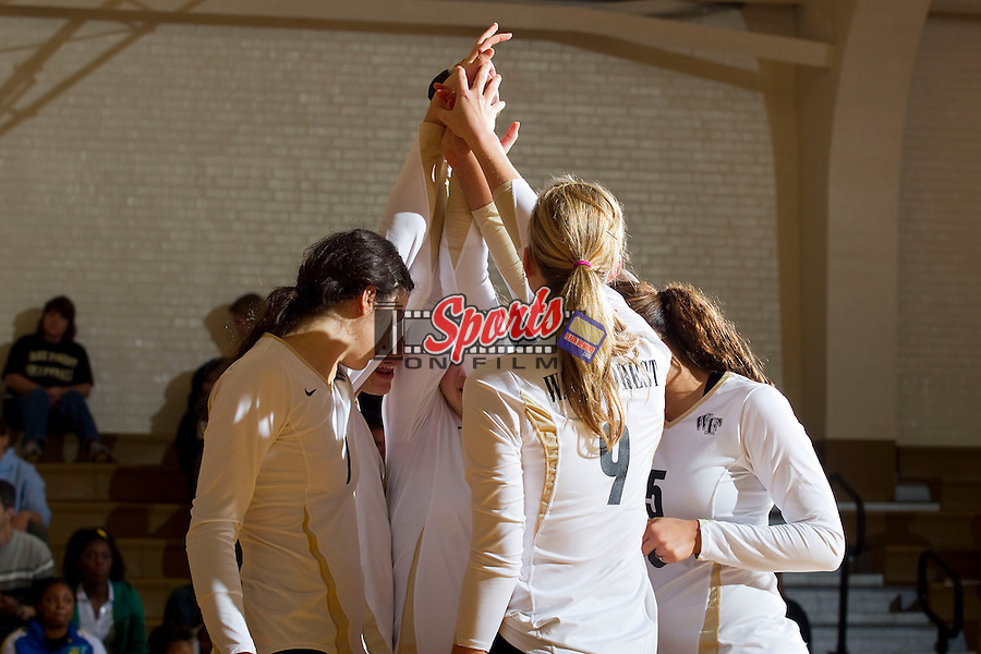 The Wake Forest Demon Deacons huddle up prior to the third set against the North Carolina State Wolfpack in Reynolds Gymnasium on October 19, 2011 in Wake Forest, North Carolina.  The Wolfpack defeated the Demon Deacons 3-0.   (Brian Westerholt / Sports On Film)
