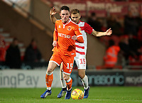 Blackpool's Jordan Thompson and Doncaster Rovers' Herbie Kane<br /> <br /> Photographer Rachel Holborn/CameraSport<br /> <br /> The EFL Sky Bet League One - Doncaster Rovers v Blackpool - Tuesday 27th November 2018 - Keepmoat Stadium - Doncaster<br /> <br /> World Copyright &copy; 2018 CameraSport. All rights reserved. 43 Linden Ave. Countesthorpe. Leicester. England. LE8 5PG - Tel: +44 (0) 116 277 4147 - admin@camerasport.com - www.camerasport.com
