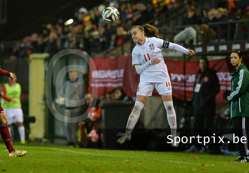 20151130 - LEUVEN ,  BELGIUM : Serbian Vesna Smiljkovic (11) pictured during the female soccer game between the Belgian Red Flames and Serbia , the third game in the qualification for the European Championship in The Netherlands 2017  , Monday 30 November 2015 at Stadion Den Dreef  in Leuven , Belgium. PHOTO DAVID CATRY