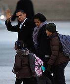 Chicago, IL - February 13, 2009 -- United States President Barack Obama (L) arrives at O'Hare International Airport with his wife Michelle (C) and daughters Sasha and Malia (R) on Friday, February 13, 2008 in Chicago. The weekend visit to Chicago is Obama's first since the Inauguration. .Credit: Brian Kersey - Pool via CNP