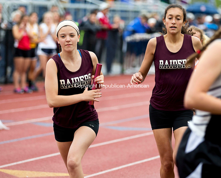 Middletown, CT- 02 June 2015-060215CM02- Torrington's Lindsey Mathieu, left, takes off after receiving the baton from teammate, Gabrielle Vega during the women's 4x800m relay at the Class MM Track and Field Championships at Middletown High School on Tuesday.    Christopher Massa Republican-American