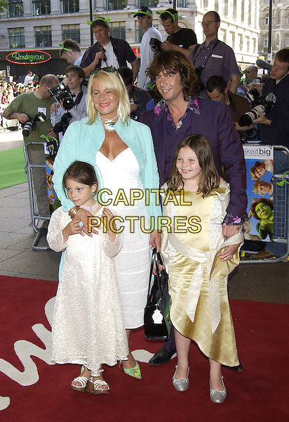 "LAURENCE LLEWELYN BOWEN.Arrivals at charity premiere of ""Shrek 2"".at Empire cinema, Leicester Square,.London, 28 June 2004..lawrence full length family wife children daughters purple suit.Ref: PL.www.capitalpictures.com.sales@capitalpictures.com.©Capital Pictures"