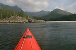Wilderness beach, Kayak bow, Vancouver Island, Sea kayaker paddling Brooks Peninsula, Checleset Bay Ecological Preserve, British Columbia, Canada, kayak bow, Mariner II by Mariner Kayaks.