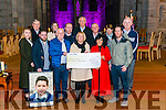 Marie and Denis O'Carroll presenting a cheque to Marie Peelo from Pieta House in the Killarney Cathedral last Friday. Pictured with l-r Aoife O'Donoghue, Killian O'Carroll and Martin Driver, back l-r Vincent Peelo, Sinead Driver, Barry O'Rourke, Michael O'Carroll, John O'Halloran, Pauline O'Halloran and Cathal Walshe