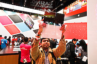 A man shows his new Microsoft tablet Surface during the opening of Microsoft's store at Times Square in New York, October 25, 2012. . Photo by Kena Betancur / VIEW.