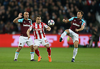 Stoke City's Xherdan Shaqiri and West Ham United's Mark Noble<br /> <br /> Photographer Rob Newell/CameraSport<br /> <br /> The Premier League - West Ham United v Stoke City - Monday 16th April 2018 - London Stadium - London<br /> <br /> World Copyright &copy; 2018 CameraSport. All rights reserved. 43 Linden Ave. Countesthorpe. Leicester. England. LE8 5PG - Tel: +44 (0) 116 277 4147 - admin@camerasport.com - www.camerasport.com