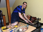 John McKeown roasts a pig on a spit at the banquet in Ardee castle. Photo: Colin Bell/pressphotos.ie