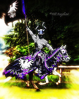 Castle Fraser Jousting tournament. Black Knight rides out to joust waving his banner. www.dsider.co.uk online magazine, photography courses